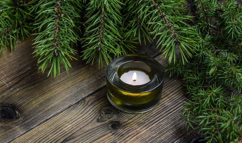 Pine and candle